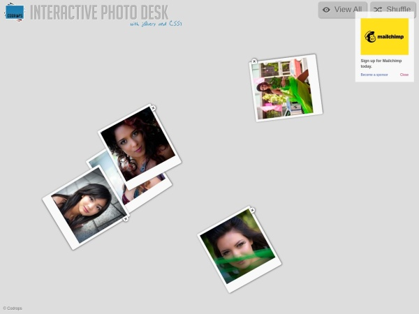 http://tympanus.net/Development/PhotoDesk/